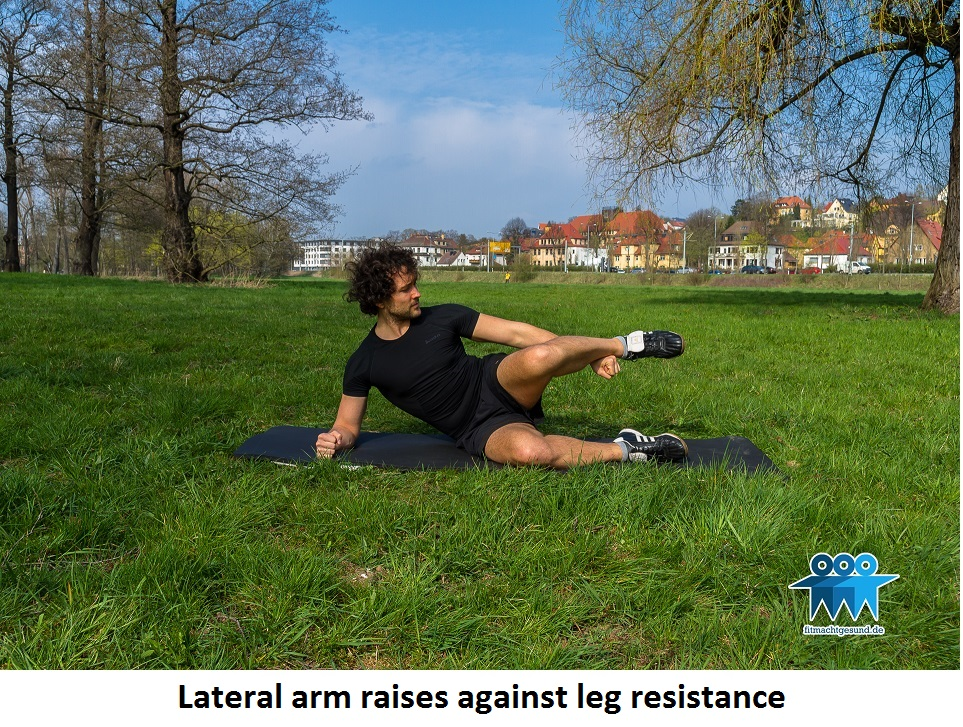 Lateral arm raises against leg resistance